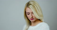Close-up portrait of a young blonde woman makes a tender elegant smile Stock Footage