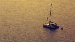 Sail boat anchored in the calm sea Stock Footage