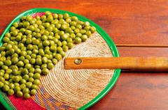 Nice display of many green lima beans. delicate layout over wooden surface Stock Photos