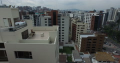 Closely Fling over the Tops of Apartment Buildings in Quito - stock footage