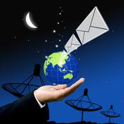 Businessman send email at night - stock photo