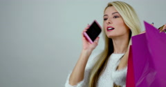 Portrait of a young excited blonde woman talks on cell phone  Stock Footage