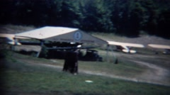 1963: Private airfield airplanes parked in grass dirt hangar. Stock Footage