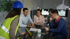 4K Portrait of smiling architect or engineer in planning meeting with colleagues - stock footage