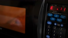 A microwave pizza cooking in a hotel room - stock footage
