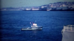 1963: Police boat patrols harbor past Kaleetan ferry boat. Stock Footage