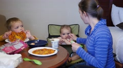 A young family eats their microwave pizzas in hotel room - stock footage