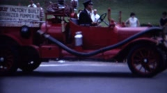 1962: Old timey fire truck first factory build motorized pumper. Stock Footage