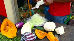 Man slicing cabbage, with a mandolin, at the market, in las terrenas, samana, Stock Footage