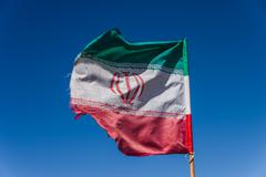 Iran flag waving in the wind - stock photo