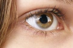 Young female hazel eye with contact lens Stock Photos