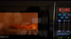 Cooking the microwave pizza in a hotel room Stock Footage