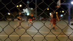 Basketball behind the wire Stock Footage