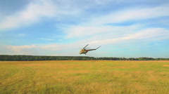 Helicopter landed in a field Stock Footage