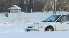 SLOW: A sport car turns on a winter ice road - side Stock Footage