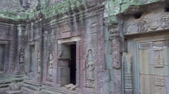 Ta Prohm temple in Angkor Wat, Cambodia, pan view Stock Footage