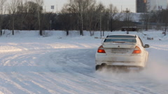 SLOW: Back view of sport car turns on a ice road Stock Footage