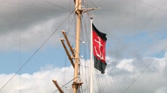 Flag with an anchor waves at the ship mast in the harbor in Gothenburg, Sweden. Stock Footage