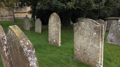 Headstones ancient cemetery St James Church Chipping Campden England 4K Stock Footage