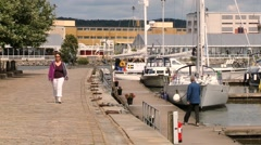 People walk at the harbor in Gothenburg, Sweden. Stock Footage