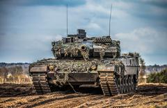 german main battle tank stands in position to shoot - stock photo