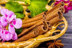 Cinnamon sticks in basket Stock Photos