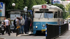 People enter tram at the public transportation stop in Gothenburg, Sweden. Stock Footage