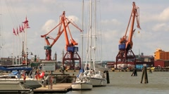View to the industrial port cranes in Gothenburg, Sweden. Stock Footage