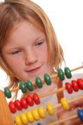 Girl doing maths - stock photo