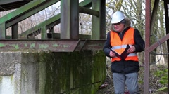 Engineer with documentation checking territory - stock footage