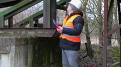 Engineer with documentation at old factory - stock footage