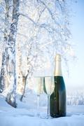 Champagne on winter background Stock Photos