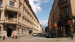 Cars pass by the street at the historical part of Gothenburg, Sweden. Stock Footage