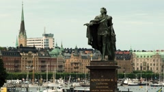 King Gustav statue with the historical buildings in Stockholm, Sweden. Stock Footage