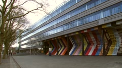 Establishing shot Dutch Ministry of Finance, facade barred with coloured stripes Stock Footage