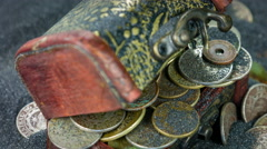 The antiquarian wooden chest with coins closeup rotation on a black sand. Arkistovideo