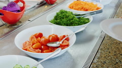 Take the chopped tomatoes on the plate in a cafe with self-service - stock footage
