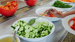 Take the sliced cucumbers on the plate and watering sauce in the cafe with self Stock Footage