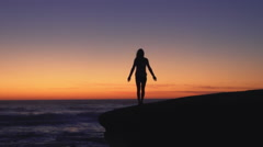 Young Woman Practicing Yoga at the Beach at Sunset, Healthy Active Lifestyle.  - stock footage