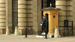 Man serves as a guard at the Royal palace in Stockholm, Sweden. - stock footage