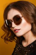amazing woman trendy, mirrored sunglasses, short wavy hair - stock photo
