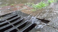 Water flowing in a drain after downpour Stock Footage