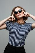 Amazing woman wear blue outfit,fashionable. Large Round Sunglasses Stock Photos