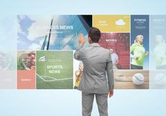 businessman with virtual projection of news pages - stock photo