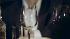 Sommelier pouring red wine into a glass Stock Footage