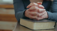 Woman Praying over a Bible - stock footage