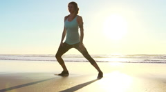 Woman Working out on Beach at Sunset. Stretching. Fitness. Tying Shoes Stock Footage