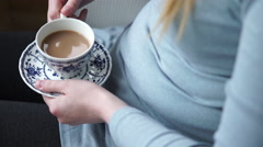 4k caucasian female hands hold pretty cup and saucer while drinking tea. Stock Footage