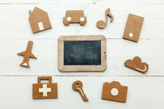 Cardboard web icons and an old blackboard on white background - stock photo