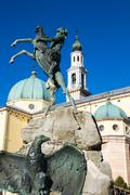 Detail of the Fountain of the Faun with the Cathedral of St. Matthew in the b - stock photo
